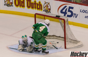 Featured Image: Edina's Anthony Walsh slips the puck through Hill Murray goatender, John Dugas to make it 4-1 for the Hornets. (Photo by Jeff Wegge)
