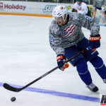 Featured Image: St. Paul's Kyle Okposo of the New York Islanders heads up the ice at the Defending the Blue Line NHL Players Charity Game. (MHM Photo By Jeff Wegge)