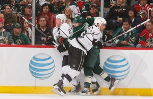 Featured Image: Willie Mitchell and Matt Greene of the Los Angeles Kings join forces to briefly neutralize the Minnesota Wild's Zach Parise, Thursday, Oct. 3, 2013, in St. Paul, Minn. The game was Mitchell's first in more than 15 months due to injury. (Photo by Bruce Kluckhohn/Getty Images)