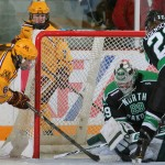 Featured Image: Minnesota's Kate Schipper is denied on one of Lexie Shaw's 32 saves in North Dakota's historic win over Minnesota on Nov. 17, 2013 in Minneapolis. (Photo / Jerry Lee, Gopher Athletics)