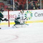 Darcy Kuemper makes a save against the Texas Stars on Nov. 1. (Photo: Reese Strickland - Iowa Wild)