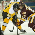 Featured Image: Dominic Toninato battles it out with CC's Jeff Collette in UMD's 5-1 win on Oct. 19, 2013 in Colorado Springs. (Photo: Casey Gibson)
