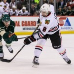 Featured Image: Chicago's Nick Leddy fires away as Minnesota's Charlie Coyle closes in on Thursday, Dec. 5, 2013 in St. Paul, Minn. The Wild defeated the Blackhawks 4-3. (MHM Photo / Jeff Wegge).