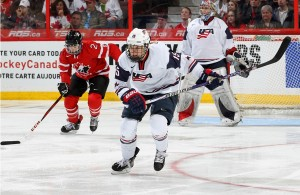 Featured Image: Team USA's Anne Schleper heads up ice against Team Canada. (USA Hockey Photo)