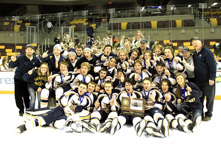 Hermantown team picture with the Section 7A championship trophy. (Photo / Dave Harwig viewthroughmylens.net)