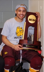 J.T. Brown with the championship trophy in the locker room. (Photo by Jordan Doffing)