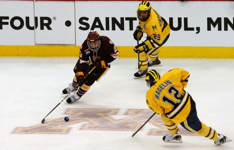 J.T. Brown takes on current New York Rangers forward Carl Hagelin in the 2011 NCAA title game. (Photo by Jordan Doffing)