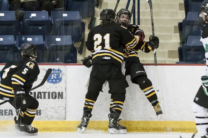 Kyle Sylvester, Jared Bethune and Koby Roth Celebrate after Sylvester's goal. (Photo / Bruce Brierley, East Grand Forks Exponent)