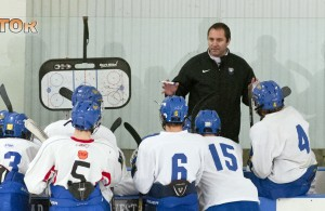 Featured Image: St. Cloud Cathedral coach Eric Johnson instructs his young team during preseason scrimmages in Moorhead in late November. (Photo / Tim Kolehmainen)