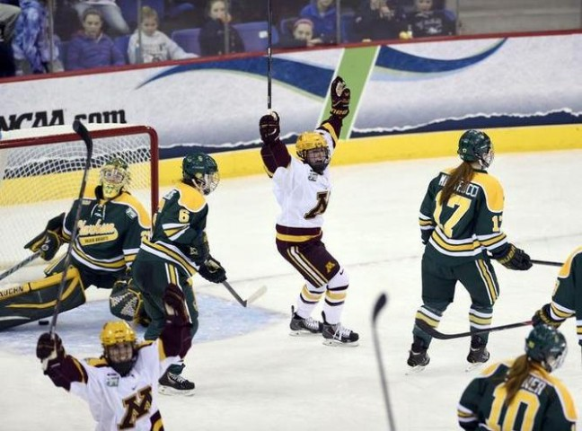 Rachel Bona (center) celebrates Baylee Gillanders' third period goal in Minnesota's game against Clarkson University in the Women's NCAA Ice Hockey Championship at the TD Bank Sports Center in Hamden, CT. Clarkson defeated Minnesota 5-4 for the school's first national title. (Credit: Sean Elliot | NCAA Photos)