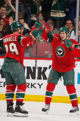 Jason Pominville #29 and Zach Parise #11 of the Minnesota Wild celebrate after scoring a goal against the Edmonton Oilers during the game on March 11, 2014 at the Xcel Energy Center in St. Paul, Minnesota. (Photo by Bruce Kluckhohn/NHLI via Getty Images)