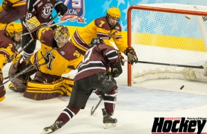 Minnesota's Brady Skjei (2), Adam Wilcox (32) and Kyle Rau (7) watch helplessly as Union's Daniel Ciampini (17) scores the third of three Dutchmen goals in a 1:54 span late in the first period of the Frozen Four title game on Saturday, April 12, 2014 at Philadelphia's Wells Fargo Center. Union won 7-4 to capture its first national championship. (MHM Photo / Jeff Wegge)