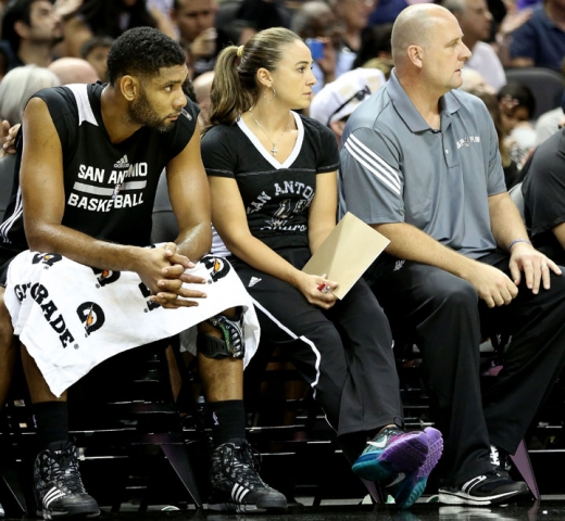 Coach Becky Hammon sits alongside Spurs star Tim Duncan during San Antonio's open scrimmage on Oct. 2, 2014 (Photo - Rebecca George / NBA.com/Spurs)