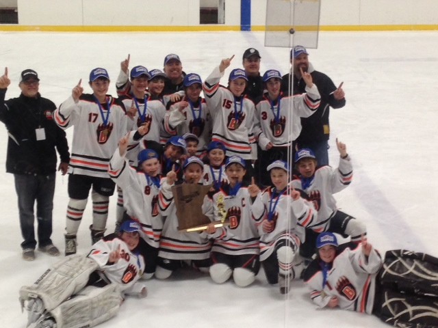 State Champs! The White Bear Lake PeeWee B teamwon the State Championship this past weekend in Two Harbors. The victory capped off a greatseason for an amazinggroup of kids. The Bears finished the season with a 35-10-4overall record. The regular season included tournament championships in White Bear Lake and Rochester. They also took home 3rd place trophies in Cloquet and Maple Grove. Then the playoff run started… The Black and Orange opened District 2 play as the #4 seed. They went on to defeat Highland Central, North St. Paul, and Stillwater to earn the D2 Championship. In the North Region,they defeated Virginia and Cloquet to set up a match up withtheir friends to the east, Mahtomedi. In the most exciting game to date, the Bears prevailed 5-4 in triple overtime to win the North Region Championship and punch their ticket to the State Tournament. In theState Tournamentthe Bears opened with a victoryover Eagan Blue 7-1, followed by a 3-2win over a highly skilled and fast Minneapolis Purple squad. This set up theState Championship gameversus pre-tournament favoriteEdina White. The title game was yet another nail bitter with many lead changes. The game was tied at 4 late in the third when the tenacious and determined Bears took the lead 5-4 with under three minutes to play. They hadto withstandthe buzzing Hornets offenseover the last two minutes to secure the State PeeWee B Title. Icing on the cake for an amazing playoff run! The State Champion Bears are Ryan Dehling, Charlie Rapheal, Ben Boldt, Cody Grahn, Tony Rossini, Nick Denault, Paul Moris, Chance Johnstone, Michael Rittenhouse, Sam Yobbie, Jacob Oczak, Roddy Schultz, Jack Montgomery, Colby Rautenberg, Nathan Thies, and Seth Valento. Coaches are Steve Oczak, Kelly Rittenhouse, Sam Schultz,Steve Moris, and manager Meg Rapheal.