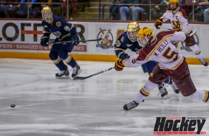 Minnesota defenseman Mike Reilly releases a slapshot against Notre Dame.