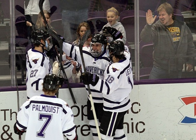 Bryce Gervais (center) celebrates with teammates after scoring one of his two goals in a Feb. 14, 2014, game against Alabama-Huntsville at the Verizon Wireless Center in Mankato. (Photo / Minnesota State University Athletics)