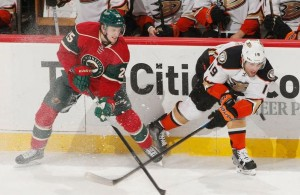 ST. PAUL, MN - DECEMBER 5: Jonas Brodin #25 of the Minnesota Wild and Patrick Maroon #19 of the Anaheim Ducks battle for the puck during the game on December 5, 2014 at the Xcel Energy Center in St. Paul, Minnesota. (Photo by Bruce Kluckhohn/NHLI via Getty Images)
