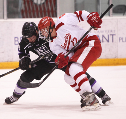 The Johnnies count on Phil Johnson (22) to produce on both ends of the ice, and the senior is a two-time All-MIAC pick. (Photo by Evan Gruenes / Saint John's Sports Information)