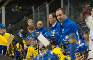 St. Cloud Cathedral coach Eric Johnson, seen here at last season's state tournament, has the red-hot Crusaders back in the MHM Class A Top 10 with sights set on a return to St. Paul. (MHM Photo / Tim Kolehmainen)