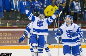 Christiano Versich celebrates # 19 Peter Tufto's 3rd goal of the game to seal St. Thomas Academy's 3-1 win over Eastview in the Section 3AA final on Thursday, Feb. 26 at Ridder Arena in Minneapolis. (MHM Photo / Jonathan Watkins)