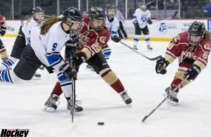Minnetonka's Annelise Rice fights to get a shot off as Lakeville South's Kyah Orr (29) and Kelsey Olsen (8) defend in the Skippers' 5-1 Class 2A semifinal win over the Cougars on Friday night at Xcel Energy Center. (MHM Photo / Jonathan Watkins)