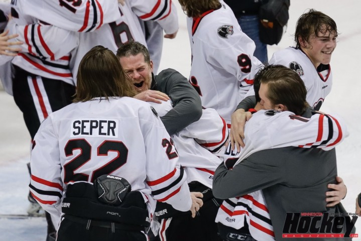 Lakeville North coach Trent  Eigner celebrates with his players after the Panthers' defeated Duluth East in the Class 2A championship game on Saturday, March 7 at Xcel Energy Center (MHM Photo / Jeff Wegge)