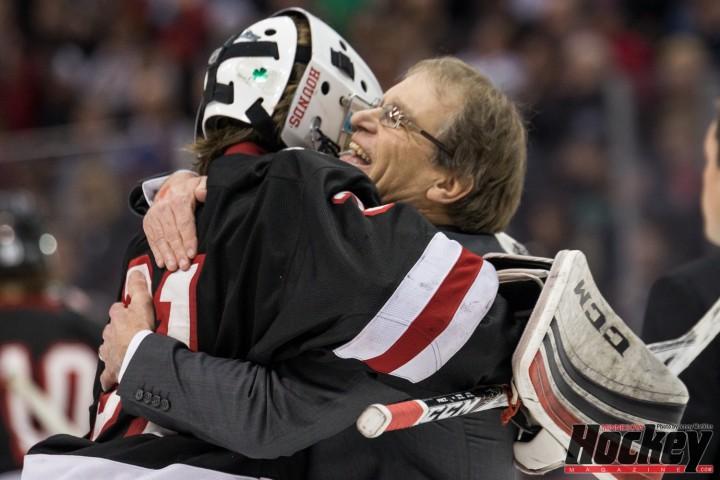 Mike Randolph embraces Greyhounds' goaltender Gunner Howg after Duluth East's improbable win over Edina. (MHM Photo / Jonathan Watkins)
