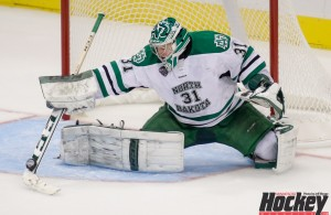North Dakota goaltender Zane McIntyre makes a save against St. Cloud State in the 2015 NCHC Frozen Faceoff semifinals at Target Center in Minneapolis. (MHM Photo / Jeff Wegge)