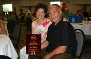 Bill Butters with his wife Debbie and the plaque for the Herb Brooks Foundation award (photo by HBF staff)
