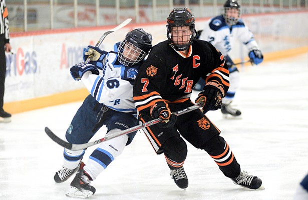 Delano captain John Keranen (7) carries the puck up ice against Superior, Wi. in the consolation semifinals of the Hilltopper Holiday Classic on Dec. 30, 2015 at Mars Lakeview Arena in Duluth.