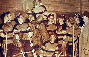 Ikola is lifted up by his teammates high above a kneeling John Mayasich as Eveleth coach Cliff Thompson looks on in approval of Eveleth's 1948 state title celebration.  (Photo courtesy of Ikola Archives - VintageMinnesotaHockey.com)