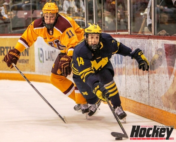 Nick Seeler (11), shown here pursuing Michigan's Tyler Motte, registered 10 points (all assists) in 36 career games with the Gophers, leading them in blocked shots (91) and a plus-21 rating. (MHM Photo / Carson Mark)