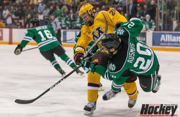 North Dakota's Gage Ausmus (East Grand Forks) is hit as he releases the puck by Minnesota's Darian Romano (Shoreview) during Minnesota's 2-0 win over UND on Nov. 5, 2016. (MHM Photo / Jeff Wegge)