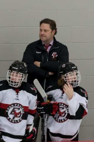 Eden Prairie assistant and former Badger Paul Ranheim looks on as his Eagles host Prior Lake on Jan. 7, 2016. (MHM Photo by Jonny Watkins)