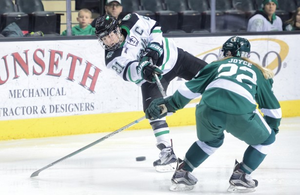 Shakopee's Amy Menke fires away as Bemidji State's Alexis Joyce defends. (Photo courtesy of Russ Hons)