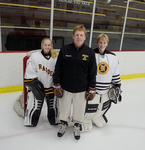 Northfield girls hockey coach Brent Bielenberg poses with his daughter, Rachel, and Ryan in this December 2015 photo. (Nick Gerhardt/Northfield News)