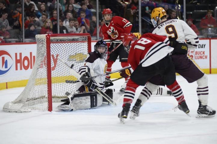 Northfield goaltender Ryan Bielenberg makes a save with the shaft of his stick. (Photo by Tim Kolehmainen / Breakdown Sports USA)