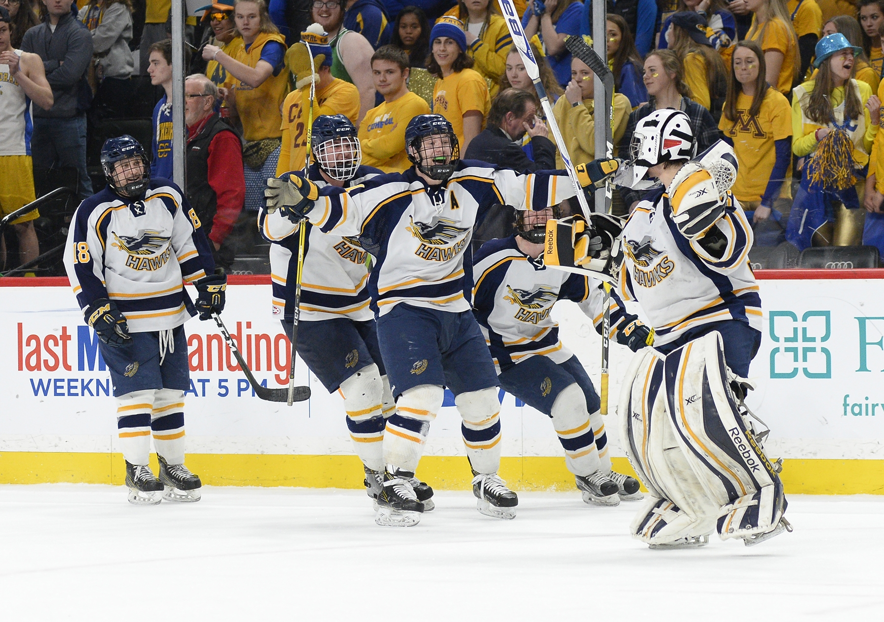 Hermantown's Ryan Sandelin celebrates with his teammates after his overtime goal beat St. Cloud Cathedral 6-5. (Photo by Tim Kolehmainen / Breakdown Sports USA)