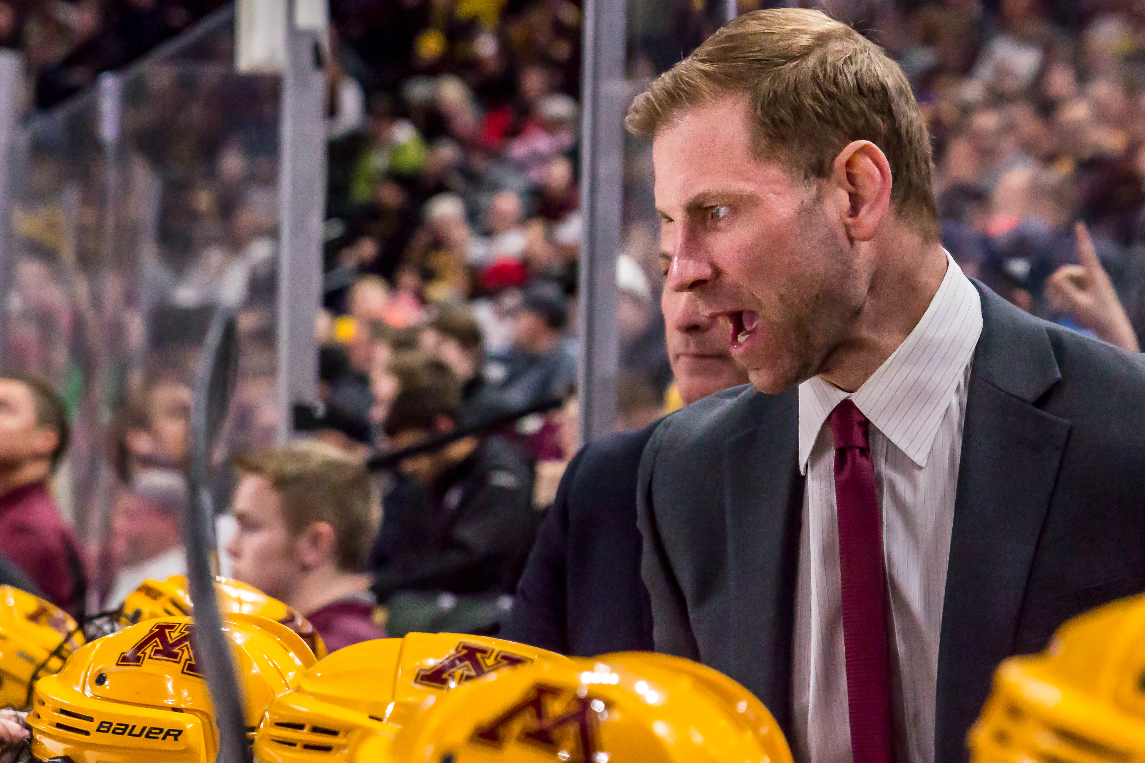 New Northern Michigan University head coach Grant Potulny instructs his players during Minnesota's 3-2 loss to Minnesota Duluth in the North Star College Cup on Jan. 27, 2017 at Xcel Energy Center. (MHM Photo / Jonny Watkins)