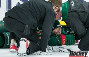 Wild assistant captain Eric Staal is tended to on the ice after he crashed head first into the boards in Saturday afternoon's 4-3 season-ending loss to St. Louis at Xcel Energy Center. (MHM Photo / Jeff Wegge)
