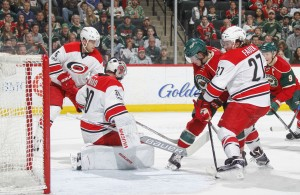 ST. PAUL, MN - APRIL 4: (L-R) Noah Hanifin #5, Cam Ward #30, and Justin Faulk #27 of the Carolina Hurricanes defend their goal against Erik Haula #56 of the Minnesota Wild during the game on April 4, 2017 at the Xcel Energy Center in St. Paul, Minnesota. (Photo by Bruce Kluckhohn/NHLI via Getty Images)
